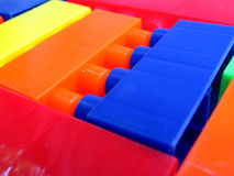 Colorful Building Blocks. A background of bright colored toy building blocks arranged randomly stock photos