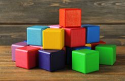 Colorful building blocks on background. Colorful building blocks on wooden background Royalty Free Stock Image