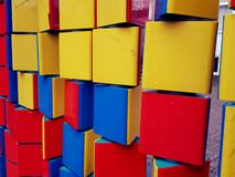 Colorful building blocks. Background of colorful rotational building blocks in a playground Royalty Free Stock Photo