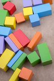 Colorful building blocks on brown background. Colorful building blocks on a brown background stock images