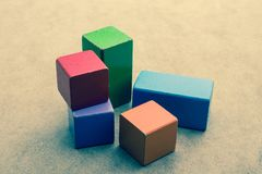 Colorful building blocks on brown background. Colorful building blocks on a brown background royalty free stock photo