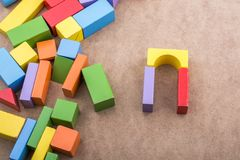 Colorful building blocks on brown background. Colorful building blocks on a brown background royalty free stock image