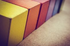 Colorful building blocks on brown background. Colorful building blocks on a brown background royalty free stock photos