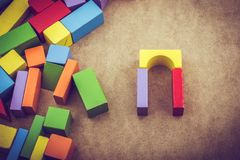 Colorful building blocks on brown background. Colorful building blocks on a brown background royalty free stock photography