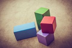 Colorful building blocks on brown background. Colorful building blocks on a brown background stock photo