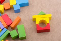Colorful building blocks on brown background. Colorful building blocks on a brown background royalty free stock images