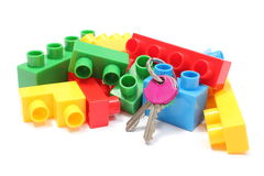Colorful building blocks for children with home keys on white background. Closeup of home keys and heap of colorful building blocks, building blocks for children Royalty Free Stock Photography