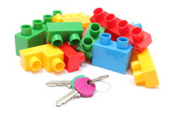 Colorful building blocks for children with home keys on white background. Closeup of home keys and heap of colorful building blocks, building blocks for children Royalty Free Stock Photos