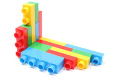 Colorful building blocks for children. Overturned wall of plastic colorful building blocks. on white background stock image