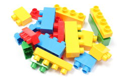 Colorful building blocks for children on white background. Heap of colorful building blocks, building blocks for children. Isolated on white background stock photo