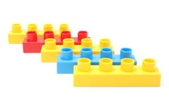 Colorful building blocks for children on white background. Closeup of colorful building blocks for children. Isolated on white background stock photography