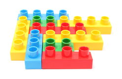 Colorful building blocks for children on white background. Closeup of colorful building blocks for children. Isolated on white background royalty free stock photo