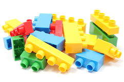 Colorful building blocks for children on white background. Heap of colorful building blocks, building blocks for children. Isolated on white background royalty free stock image
