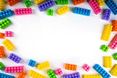 Colorful building blocks with copy space in the middle. Top view royalty free stock image