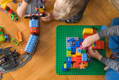 Colorful building blocks. Two boys playing with colorful building blocks Royalty Free Stock Image
