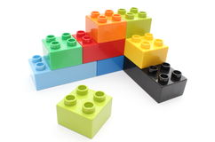 Colorful building blocks on white background. Closeup of building blocks isolated on white background royalty free stock photo