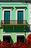 A colorful building in Caribbean. A cyan color building with decorative metal balcony in a Caribbean city stock photo