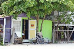 Colorful building on Caye Caulker. Bicycle parked in front of a colorful building on Caye Caulker, Belize stock photography