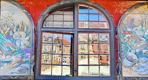 Colorful building exterior. Old windows .Historic building windows stock photography