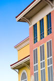 Colorful building facade. A view of the facade or front side of a colorful commercial building stock photography