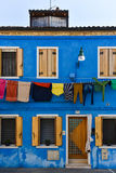 Colorful Building Facade. Blue building facade with clothes hanging stock image