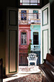 Colorful building facade in Cuba. Old buldings viewed through balcony in Havana, Cuba royalty free stock photo