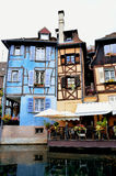 Colorful building facades and canal, Colmar (France. Several buildings with colorful facades direct at the canal in Colmar, brilliant small town in France. The stock photos