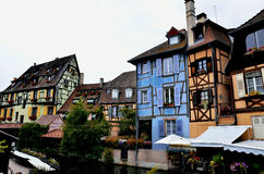 Colorful building facades and canal in Colmar,France. Several buildings with colorful facades direct at the canal of Colmar, France hometown of Frederick royalty free stock images