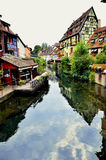 Colorful building facades and canal in Colmar,France. Several buildings with colorful facades direct at the canal in Colmar the Little Venice (la Petite Venise) royalty free stock photo