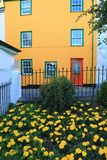 Colorful building and garden. In Lyme Regis in Dorset royalty free stock images