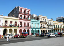 Colorful building in havana. Colorful building in spanish style with old cars parking in the front in Havana, Cuba royalty free stock photography
