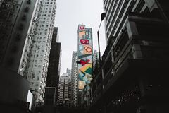 Colorful building on one of streets in hong kong. Colorful building in hong kong china royalty free stock photos