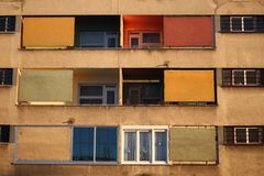 Colorful building. Red, yellow and green windows and balcony on an old building royalty free stock photos