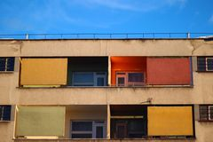 Colorful building. Red, yellow and green windows and balcony on an old building royalty free stock images