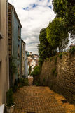 Colorful buildings along the stairs next to the stone wall, desc Royalty Free Stock Images