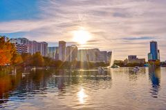 Free Colorful Buildings And Autumn Forest At Lake Eola Park On Beautiful Sunset Background In Orlando Downtown Area 1 Royalty Free Stock Photos - 139003818