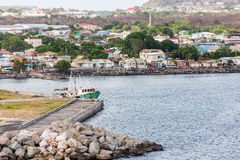 Colorful Buildings Beyond Pier on St Kitts Stock Image