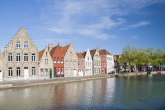 COLORFUL BUILDINGS ON CANAL IN BRUGGES, BELGIUM Stock Images