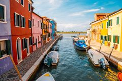 Colorful buildings and canal in Burano island, Venice, Italy