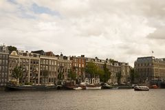 Buildings and canal in the Amsterdam city royalty free stock image