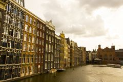 Buildings and canal in the Amsterdam city stock image