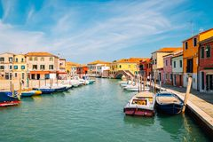 Colorful buildings and canal in Murano island, Venice, Italy