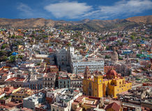 Colorful Buildings and Cathedral in City of Guanajuato from Mexico Against Cloudy Blue Sky royalty free stock photo