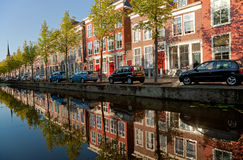 Colorful Buildings of Delft and Their Reflection in Canal Stock Photography