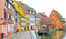 Colorful buildings in front of a river in Colmar, France. Stock Photography