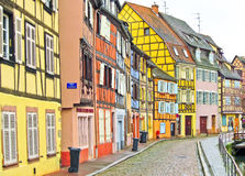 Colorful buildings in front of a river in Colmar, France. Royalty Free Stock Image