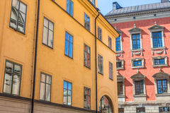 Colorful Buildings in Gamla Stan Stockholm. An Orange and Red Building in Gamla Stan Stockholm with a Blue Cloudy Sky Stock Photo