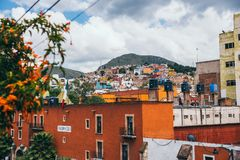 Colorful buildings of Guanajuato in a cloudy day stock image
