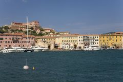 Colorful buildings and harbor of Portoferraio, Province of Livorno, on the island of Elba in the Tuscan Archipelago of Italy, Euro Royalty Free Stock Images