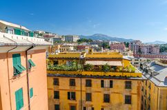 Colorful buildings on hill in city district of Genoa Genova and Monte Fasce mountain of Ligurian Appennines range royalty free stock photography